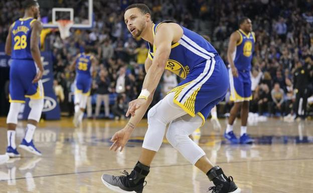 Stephen Curry, durante un partido con los Warriors./Reuters